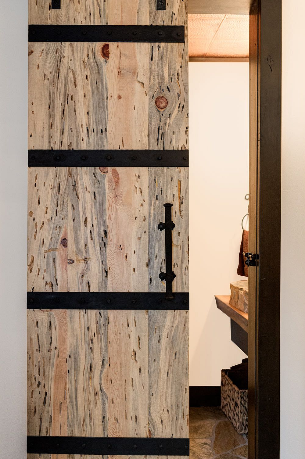 Custom wormwood door with metal bands.
