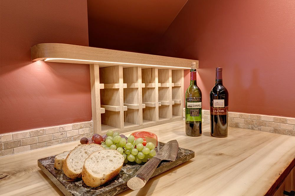 Wine room built in under the stairs.