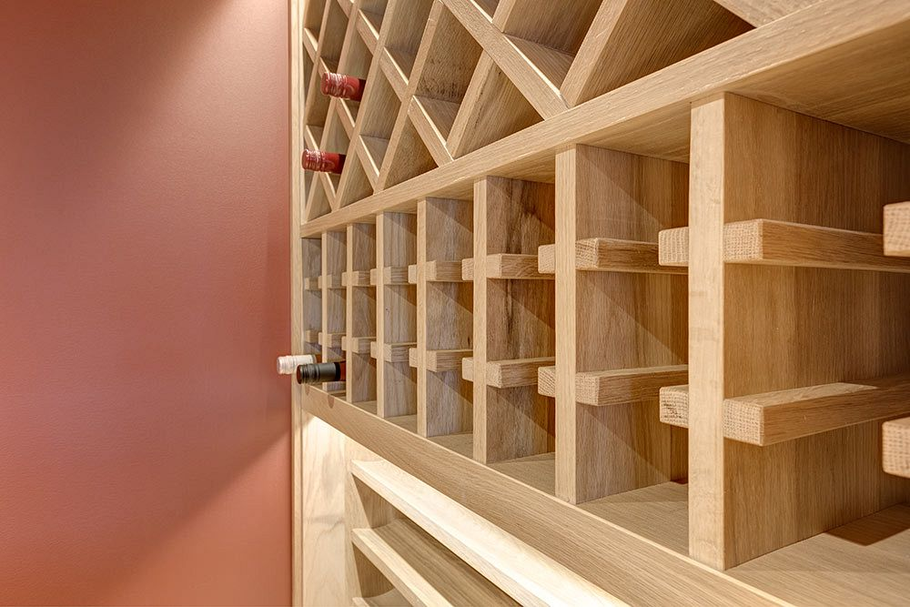 Wine room built in under the stairs, full use of space.