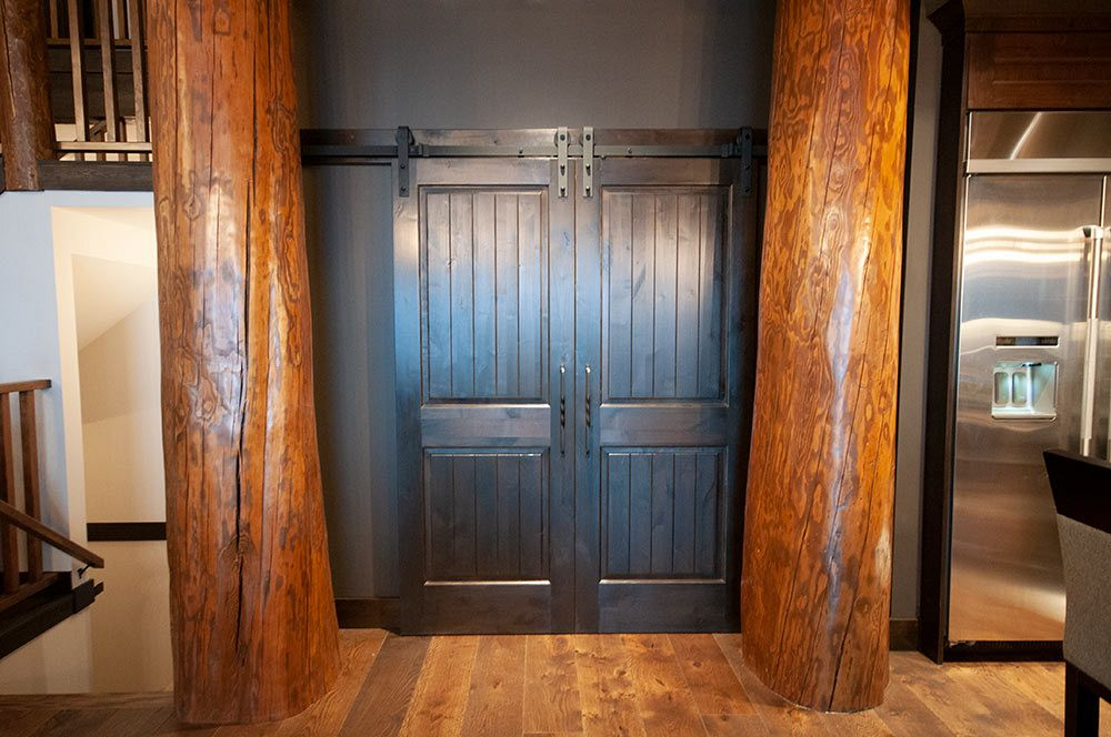 Hand scraped logs frame this unique office door.
