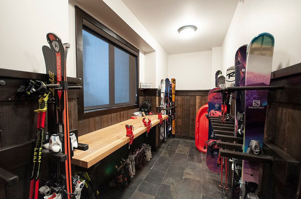 Custom built ski work bench and ski/equipment rack.
